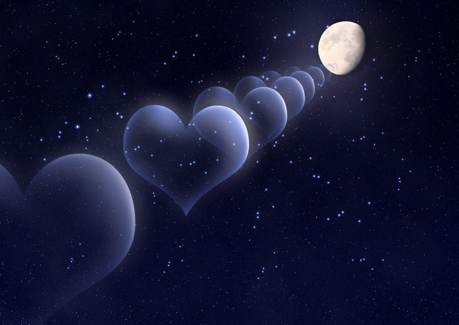 Bubbles in the shape of a heart against the moon in space
