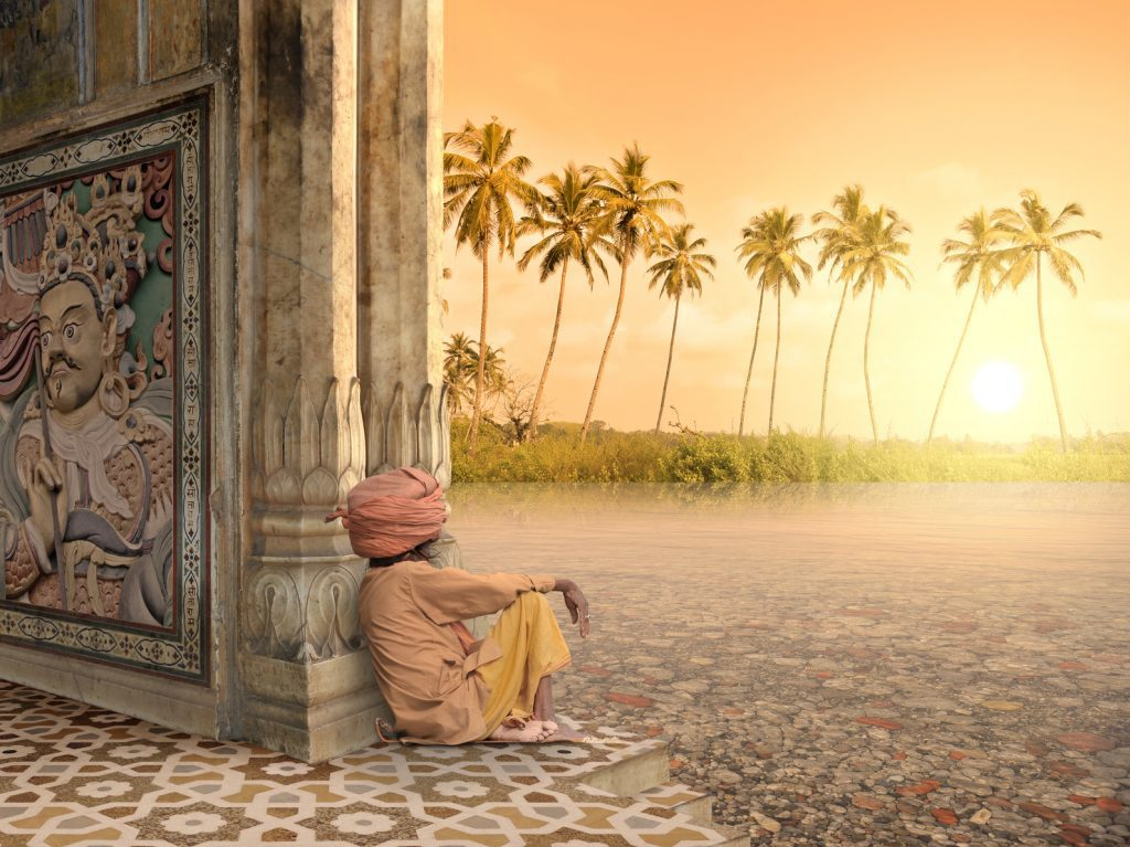 hombre la religión hinduista contempla la puesta de sol